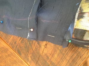 Lining lays over the zipper matching all raw edges.